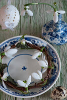 Small wreath of snowdrops in blue-and-white dish