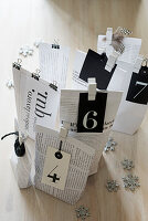 Black and white gift bags made from hand-crafted from newspaper and book pages
