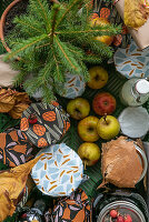 Preserving jars, small fir tree and apples