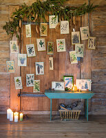 Vintage greetings cards hung from festive garland