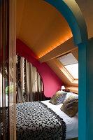Double bed in Moroccan-inspired bedroom