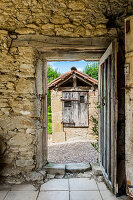 French country house made of natural stones with wooden door