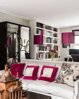 Fuschia sating shades with mirrored cabinet and bookcase