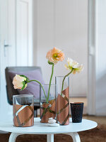 Flowers in hand-decorated glass vases
