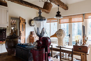 American 1920's coffee grinder and large goose head in kitchen of barn conversion