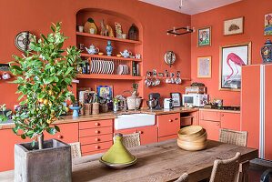 Warm country kitchen, wooden table and tagine pot