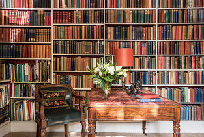 Antique desk and bookcases with green leather chair