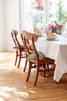 Set table with chairs in bright dining room