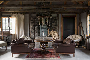 Seating area with leather sofas in renovated forge
