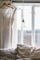 Lingerie by the window in the bedroom, view of fields