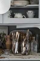 Vintage china cupboard, glasses as cutlery holders