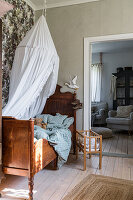 Rustic wooden bed with canopy in the children's room