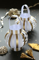 Lanterns handmade from gold and white striped paper