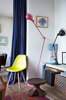 Stool, yellow classic chair, lowboard and lamps in the room