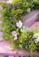 Wreath of lady's mantle, mallows, Queen Anne's lace and gypsophila