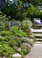 Summer garden, lounger on patio in background