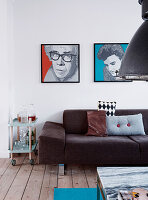 Modern art above upholstered sofa and serving trolley in living room