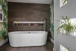 OVal bathtub in modern bathroom with houseplants in niches in wall