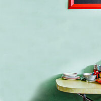 Light green wall and kitchen table