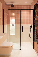 Floor-level shower in small bathroom with two-tone walls