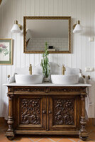 Antique cupboard with two top basins in the bathroom