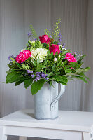 Bouquet of carnations, roses and gaultheria leaves