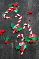 Candy cane decorations handmade from pipe cleaners and pompoms