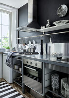 Stainless steel elements in a kitchen in black and white
