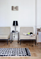 Two armchairs in a classic living room with parquet floor