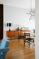 Retro sideboard, classic table and chairs in the living room