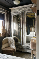 Old, shabby-chic wardrobe and vintage-style accessories in bedroom