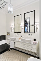 Twin sinks in elegant, classic, black-and-white bathroom