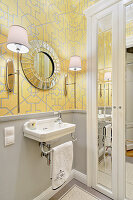 Yellow wallpaper with graphic pattern in small, elegant bathroom