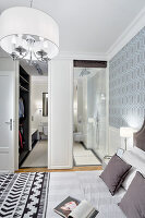 Walk-in wardrobe and ensuite bathroom in elegant bathroom