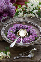 Wreath of lilac florets in silver dish