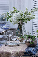 Bouquet of white lilac in silver vase