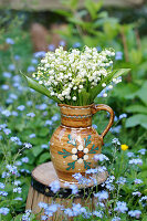 Bouquet of lily-of-the-valley in rustic ceramic jug