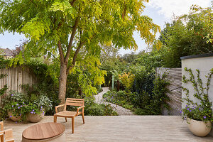 Chair on terrace and view of garden with gravel patch