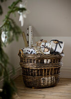 Wicker basket filled with Christmas presents