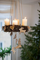 Suspended Advent wreath decorated with gingerbread shapes