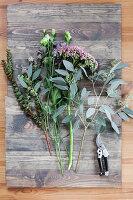 Tying an autumn bouquet with eucalyptus and sedums