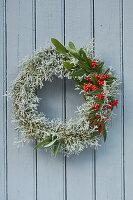 Wreath of Santolina and Cotoneaster with berries on door