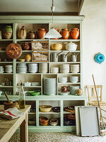 Provencal French kitchen with crockery stored in dresser