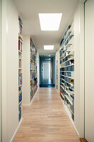 Long hallway lined with shelving