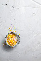 Yellow bath salts with dried flower petals