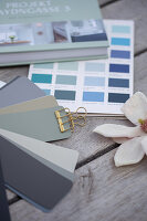 A colour card with shades of blue and grey