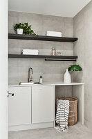 Modern utility room in shades of grey