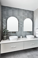 Washstand with twin countertop sinks below mirrors