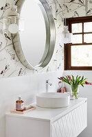 Washstand with round countertop sink below mirror
