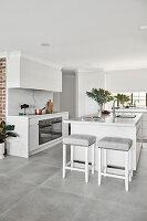 Island counter in elegant white kitchen